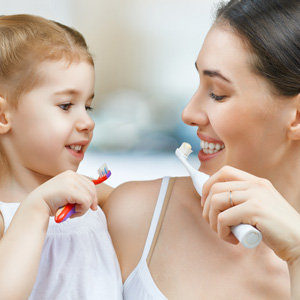 Mother & Daughter Brushing their teeth