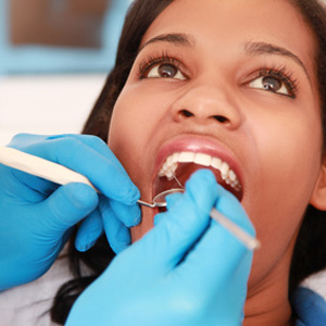 Women get her teeth serviced